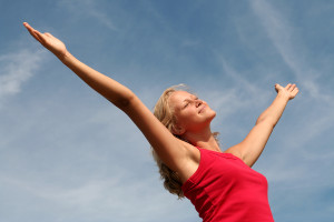 happy-woman-with-her-arms-wide