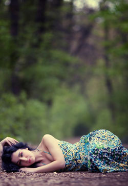 Lost ine the woods of depression sad woman lying in forest
