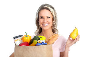 smiling-young-woman-holding-a-shopping-bag